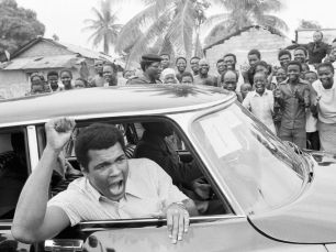 Ali arrives in Kinshasa, Zaire to meet Foreman for the Rumble in Jungle