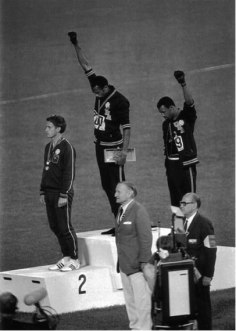 Peter Norman, Tommie Smith & John Carlos (all three wearing OCHR buttons)